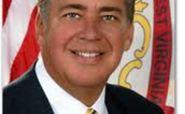Tomblin stands up for miners