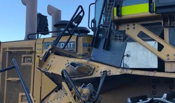 Two dozers collide after operator looked backwards