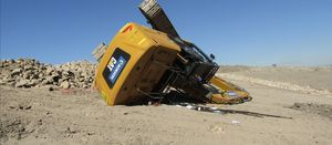 Overturned excavator leaves operator with headache