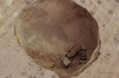 Sinkhole swallows explosives truck
