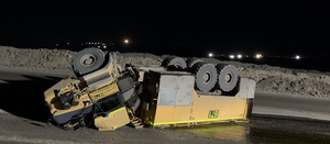 Truck overturns on ramp after dust suppression