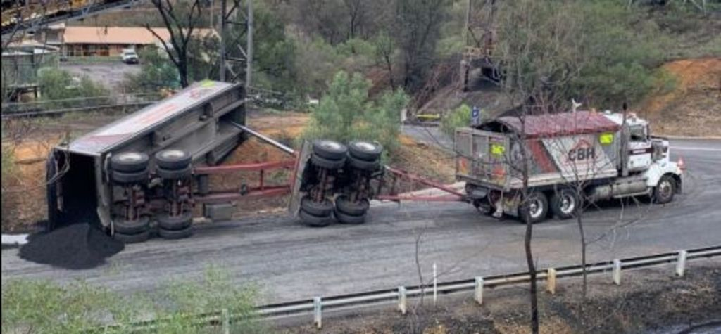 Tipper truck tips over