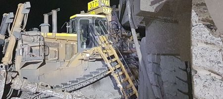 Dozer and dump truck collide