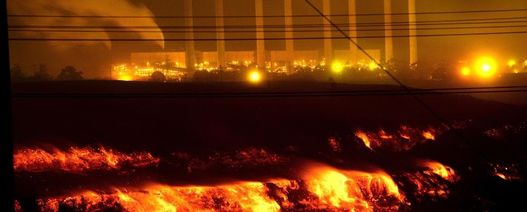 Mega-fire threatens mine, power station